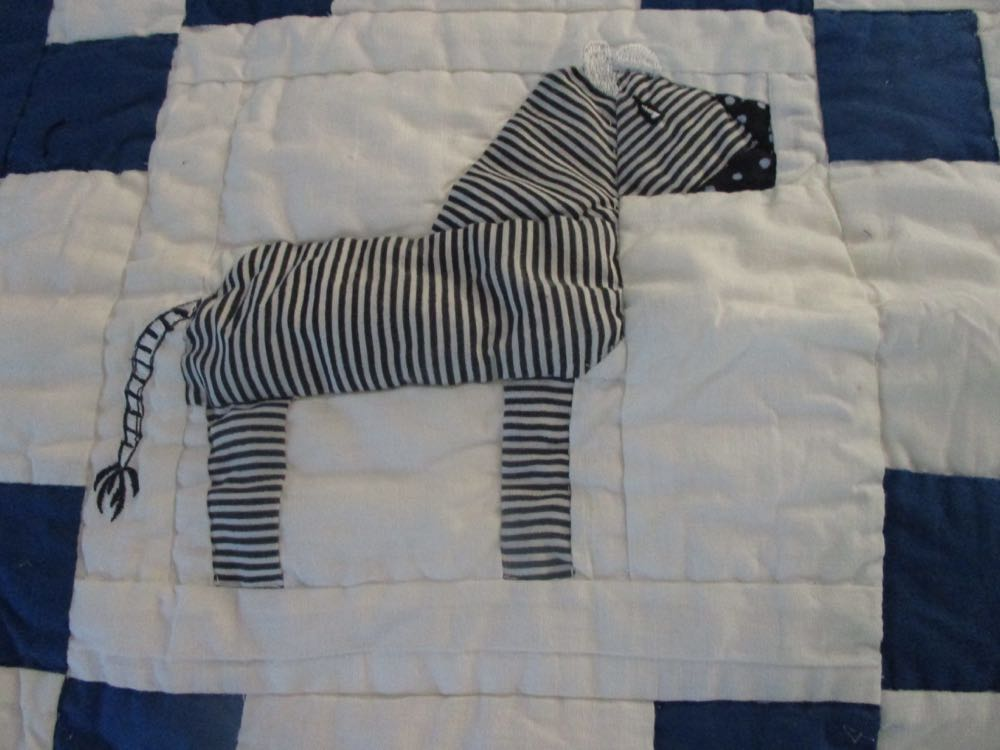 Cute zebra has a very detailed tail with embroidery details.