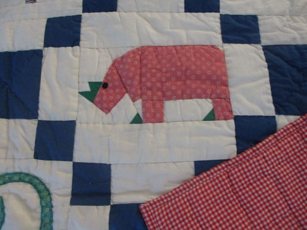 This applique hippo has green details that help it stand out in the overall design.