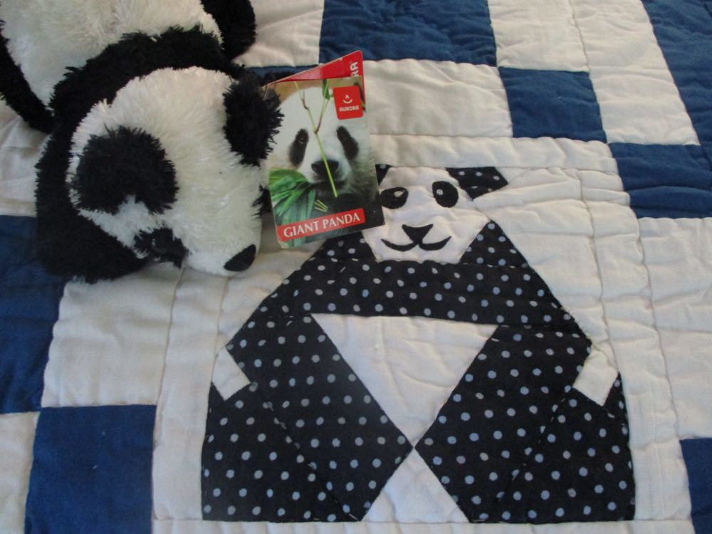 Delighted to find a panda that matches the applique panda on the baby crib quilt.