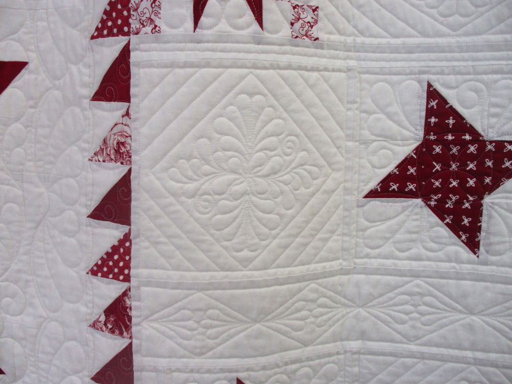 The detailed quilting on this handmade quilt was varied and filled up the white spots.
