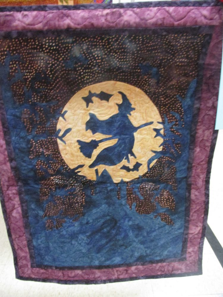 Midnight Ride Quilt Wall Hanging would make a wonderful addition to a house entrance.