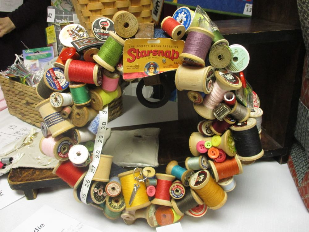Vintage sewing thread spools wreath up for auction at a recent quilt guild annual show.