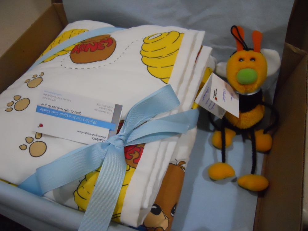 The little Gund honeybee is delivering the free gift tag with the handmade baby crib quilt.