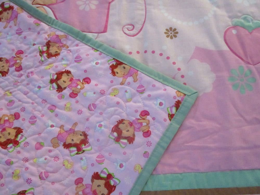 Flannel Baby Strawberry Shortcake fabric is on the back of this charming baby crib quilt.