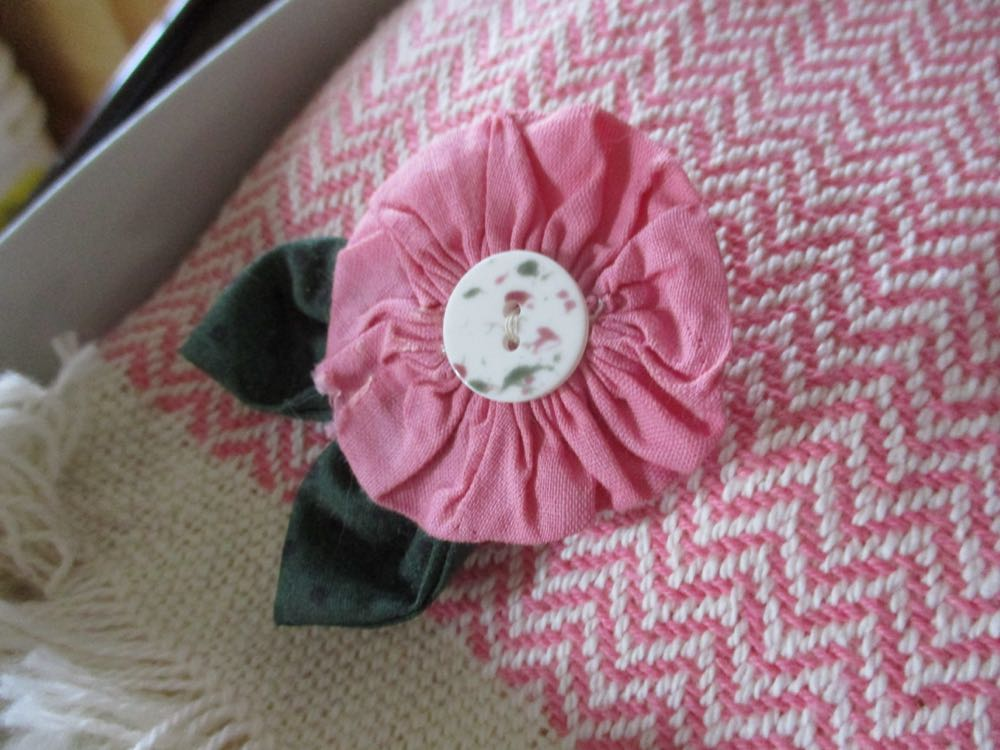 Lucky that the handmade flower pin happens to match the pink kitchen towels!