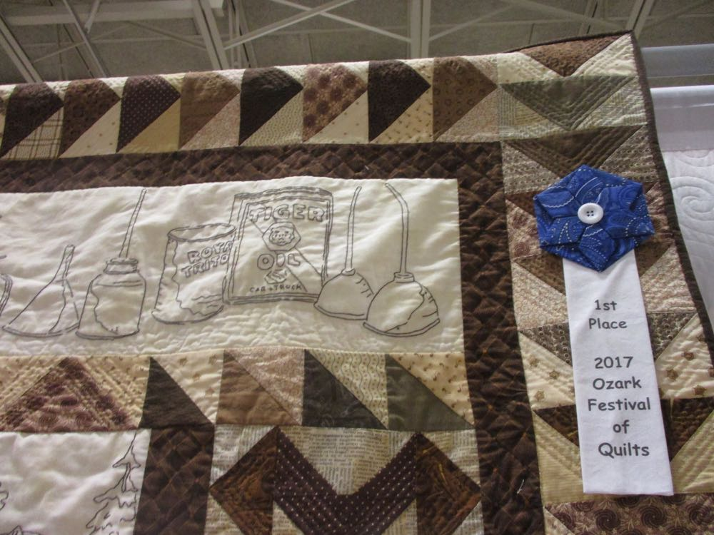 The first place ribbon in the shape of a flower is also a unique way to recognize these quilts.