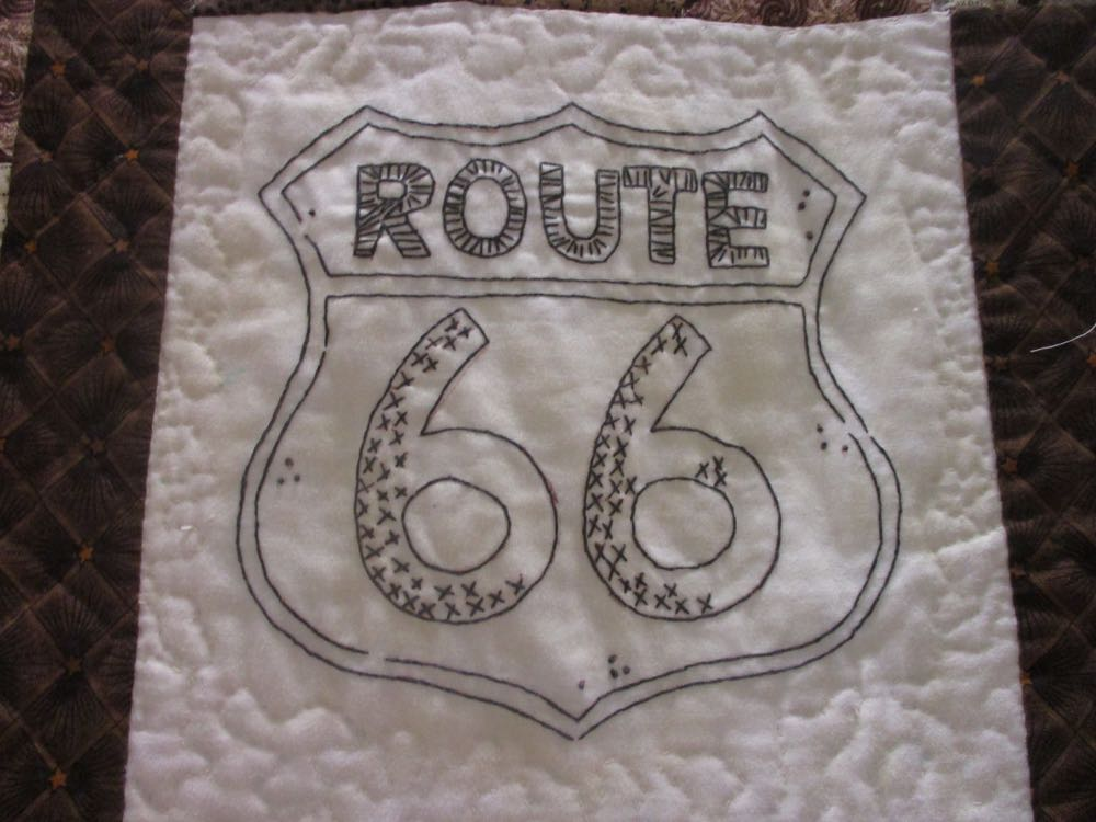 A close up of the traditional Route 66 sign in the embroidered design.