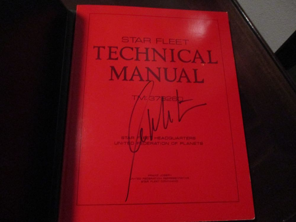 This is 1975 First Edition Star Fleet Manual autographed by William Shatner up for auction.