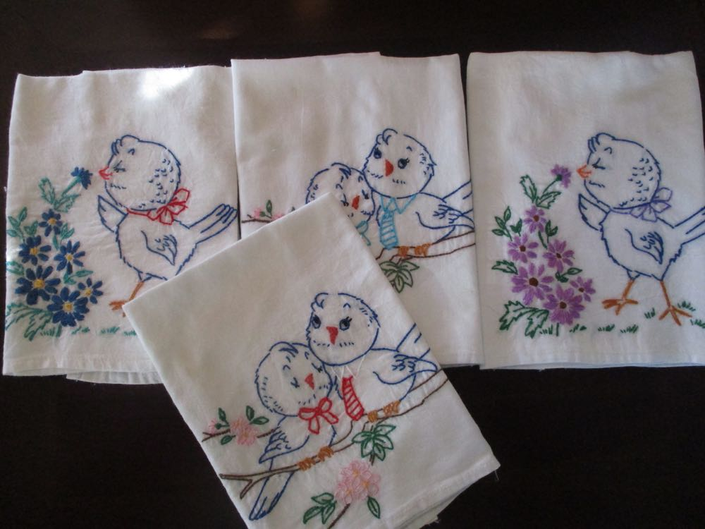 Charming hand embroidered bluebird dish towels ready to add color to a kitchen!