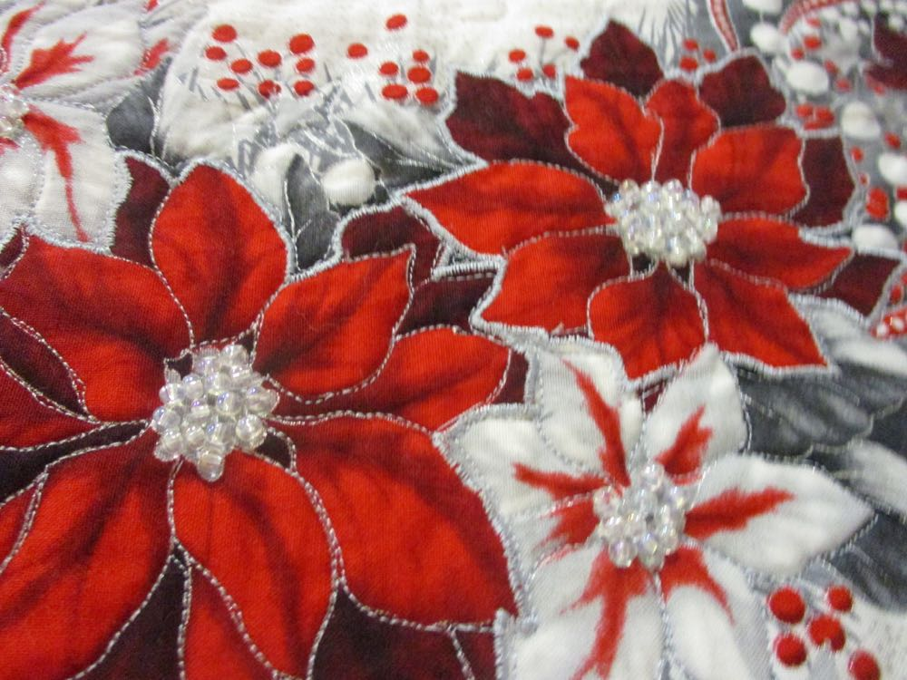 Love the way Marilyn used beads to make the Poinsettia flowers inside the red and white leaves.