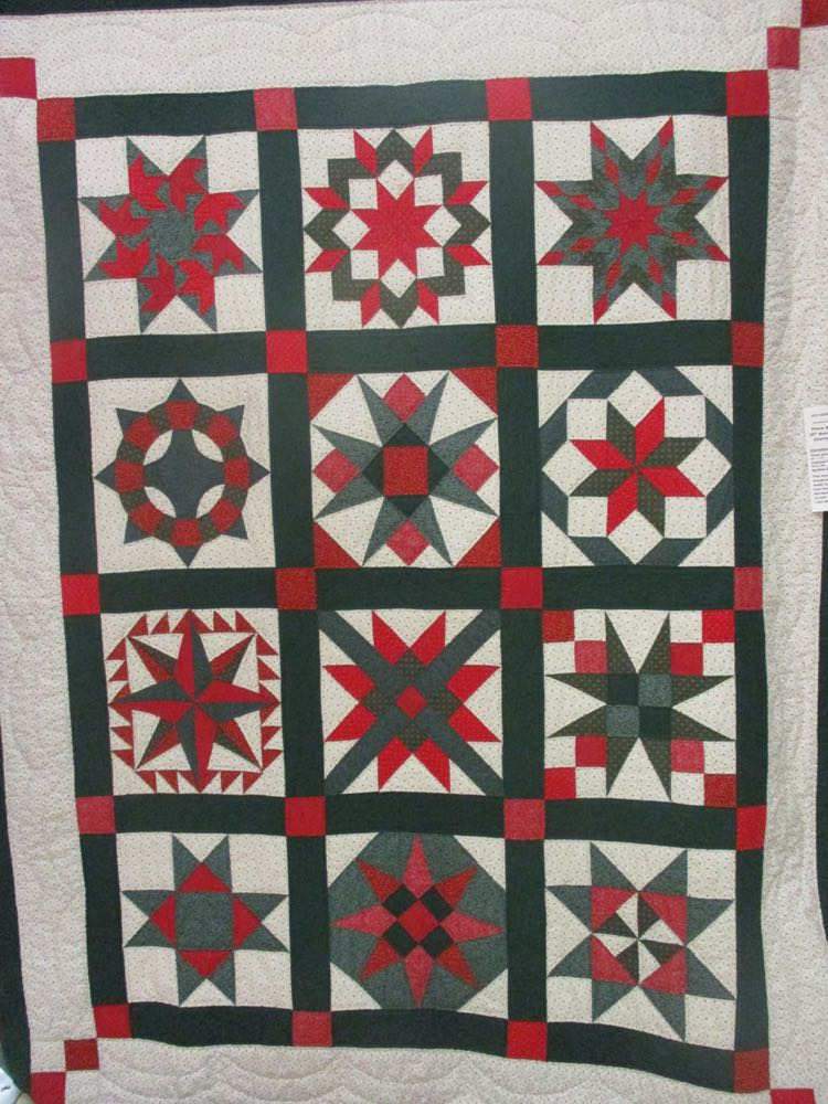 Each of the blocks in this Christmas Sampler handmade quilt are different.