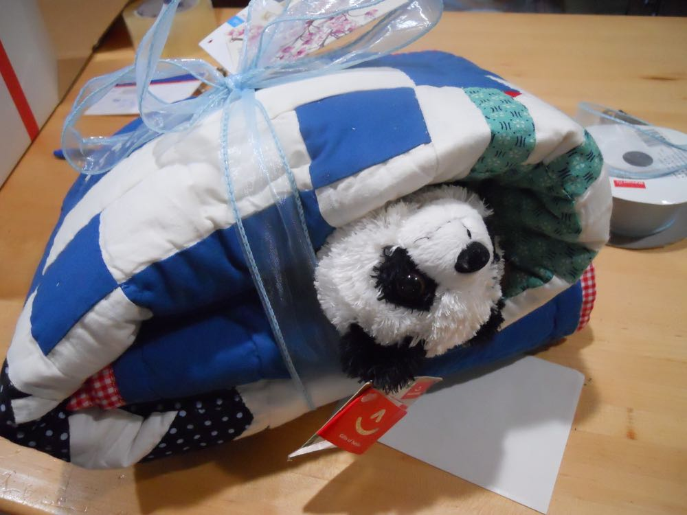 My favorite way to personalize a baby gift, to add a complimentary toy tucked inside a quilt!