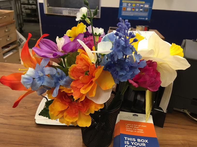 These silk flower bouquets greet visitors to our local post office, aren't they welcoming?