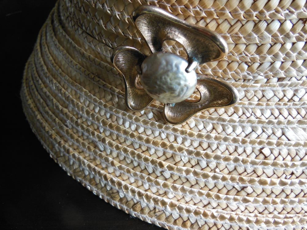 One of my favorite combinations, this pearl pin with a summer straw hat. (Photo by Charlotte Ekker Wiggins)
