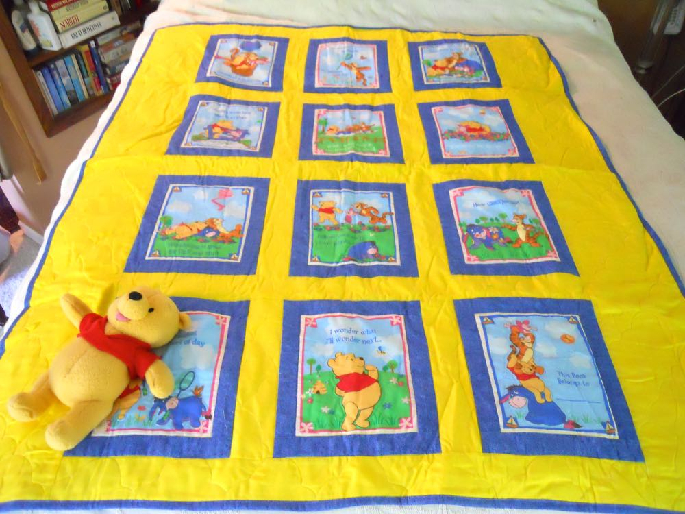 Our one of a kind Pooh Adventure Baby Quilt Gift Set includes a Pooh Bear rattle toy.