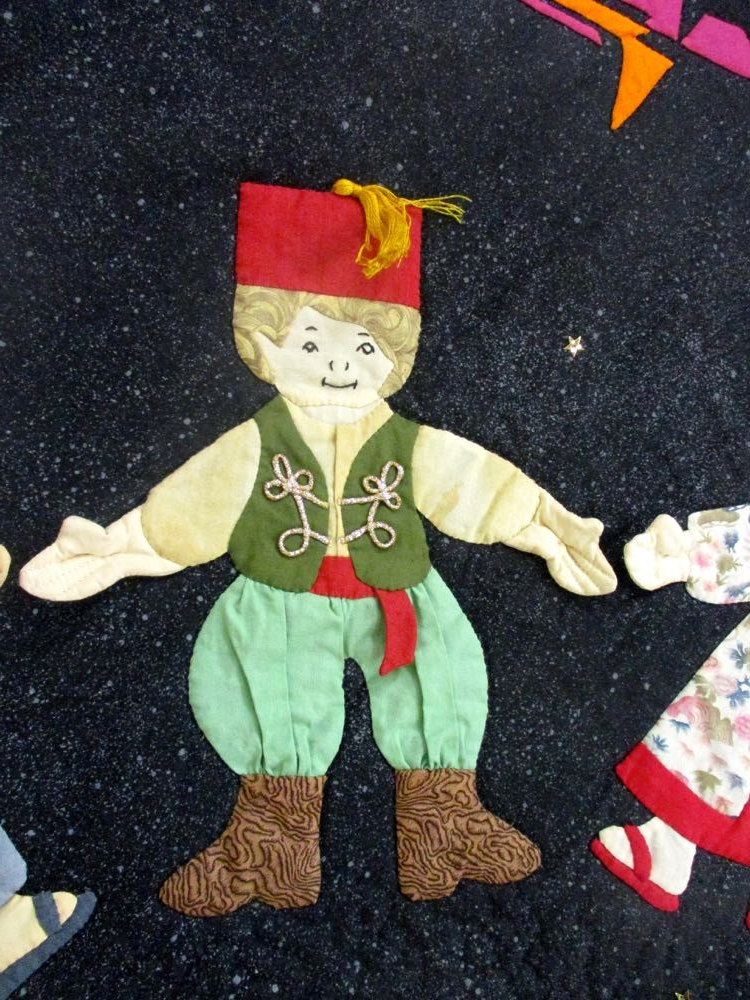 Details of one of the boy characters in Alan's Quilt wall hanging by Bobbie Wedge.