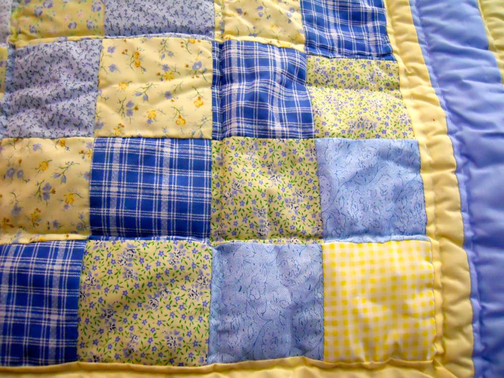 Close up of the 4-inch fabric blocks in Blue Yellow Ninepatch lap quilt and wall hanging.