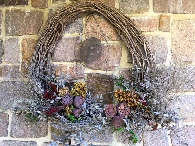 This large wild grape vine wreath hangs from a dowel in the mortar. (Photo by Charlotte Ekker Wiggins)