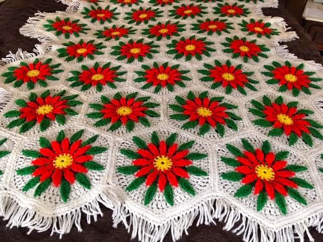 This poinsettia lap quilt throw easily brings a holiday vibe. (Photo by Charlotte Ekker Wiggins)