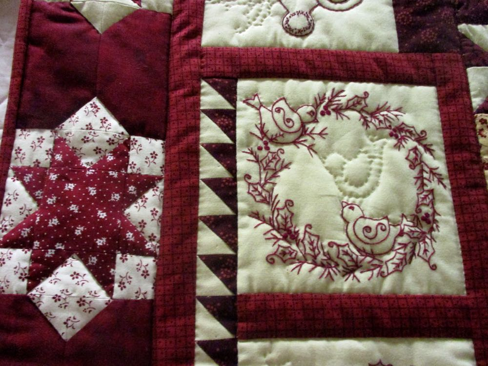 Two charming embroidered birds in Winter Twitterings Handmade quilt, (Photo by Charlotte Ekker Wiggins)