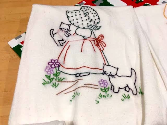 Two cats keep Sunbonnet Sue company in this custom kitchen towel. (Photo by Charlotte Ekker Wiggins)