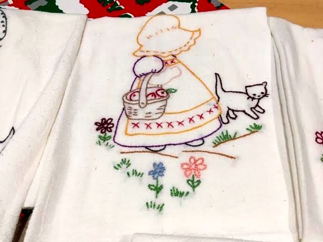 Sunbonnet Sue carrying a basket of apples in this kitchen towel. (Photo by Charlotte Ekker Wiggins)