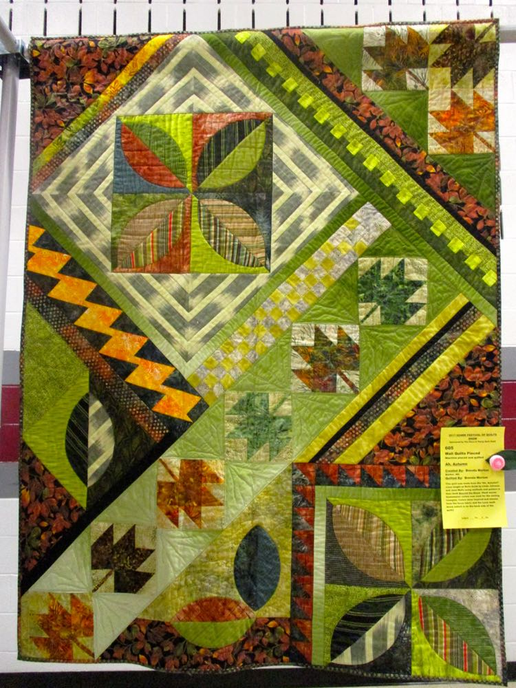 This handmade quilt features traditional autumn colors. (Photo by Charlotte Ekker Wiggins)