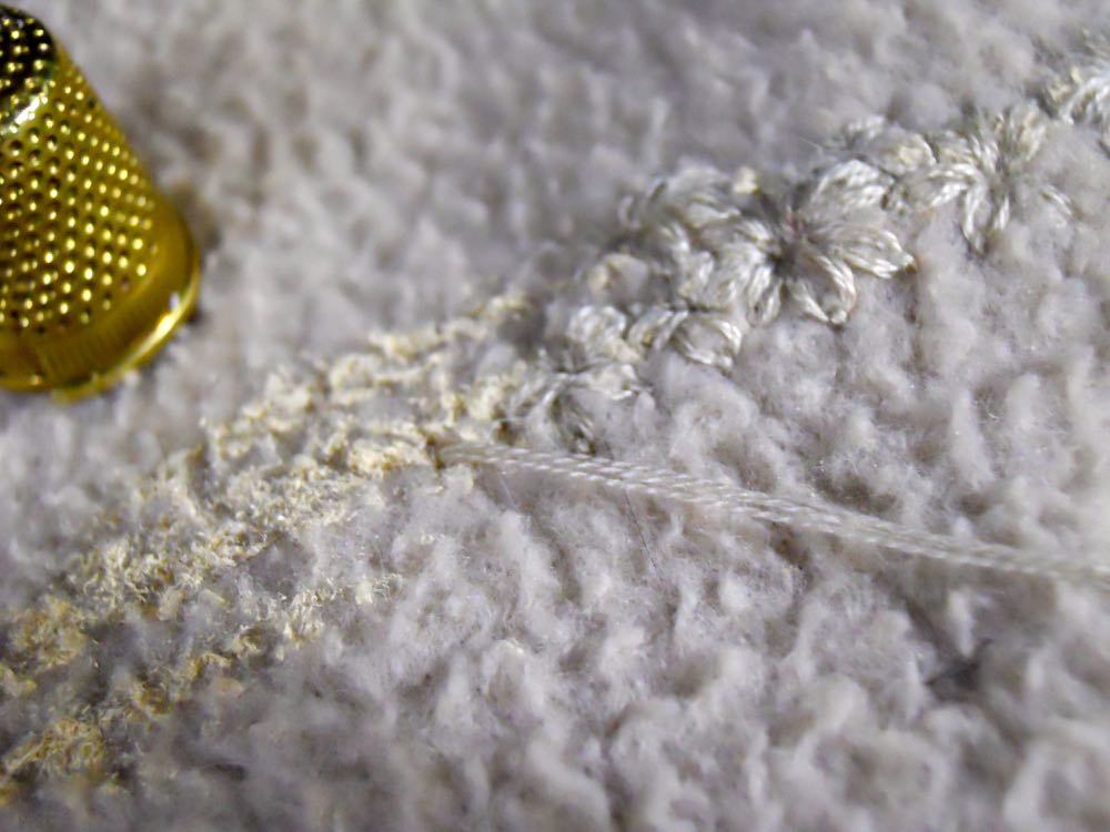 As you embroider, see how the matching floss color covers the paint. (Photo by Charlotte Ekker Wiggins)