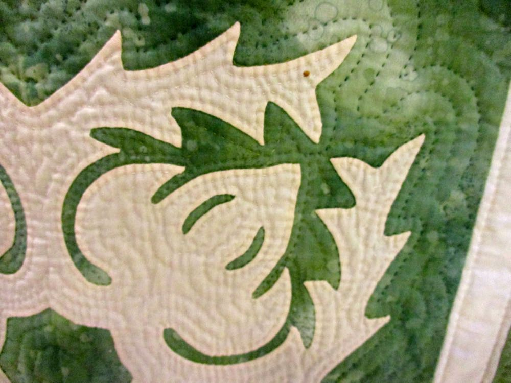 The handquilting adds dimension to this Green Hawaiian Handmade Quilt (Photo by Charlotte Ekker Wiggins)