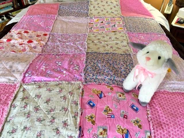 This pink large rag blocks baby quilt is for that little girl moving into a big bed. (Photo by Charlotte Ekker Wiggins)
