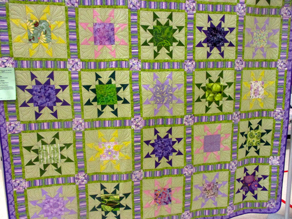Wink and a Smile Handmade Quilt from 2017 Piece and Plenty Quilt Guild. (Photo by Charlotte Ekker Wiggins)