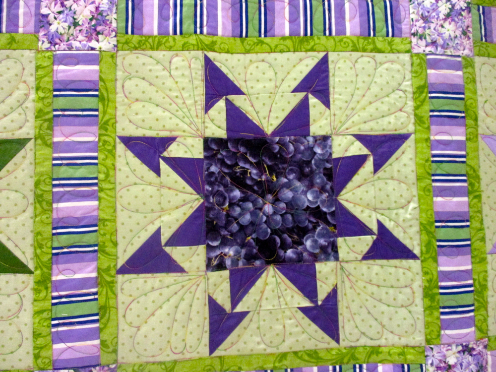 Purple Wink and a Smile Handmade Quilt block. (Photo by Charlotte Ekker Wiggins)