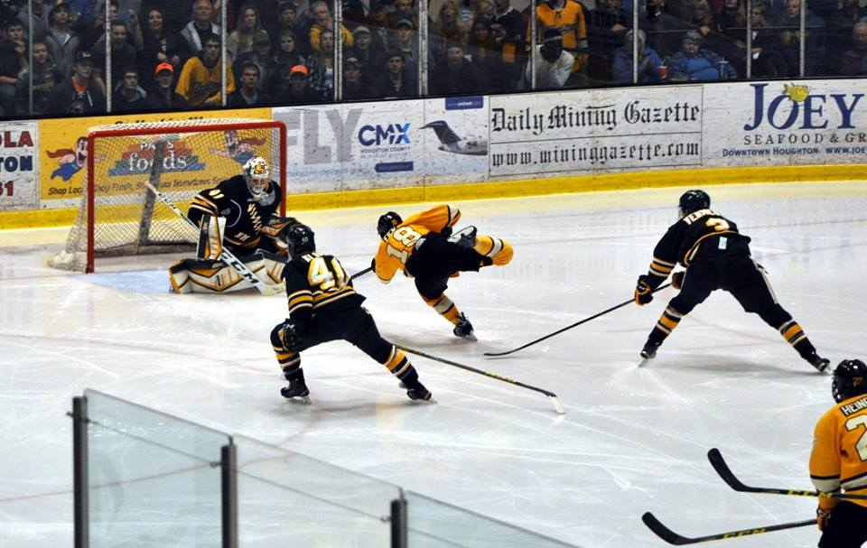 CJ Eick takes a breakaway shot on goal against NMU  netminder Alte Tolvanen on Oct 24th, 2015. Photo by THG Staff Photographer Bob Gilreath.