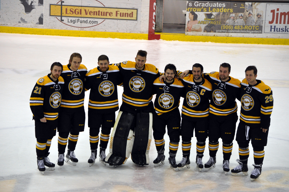 The 2016 seniors stand together during Senior Night festivities on March 4th, 2016. Photo credit Bob Gilreath.