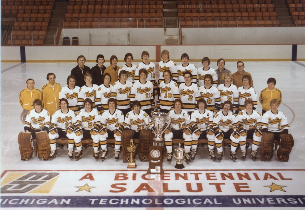 The 1975-76 WCHA Championship Team with all of their hardware - photo courtesy of michigan tech athletics