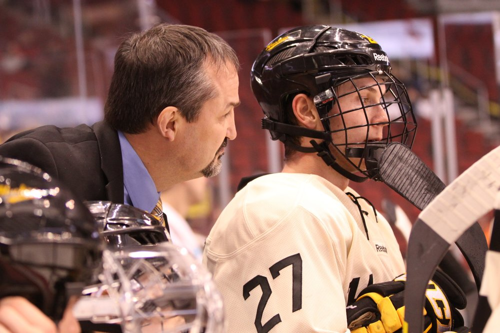 Assistant Coach Gary Shuchuck talks to Tyler Heinonen during last season's game against University of Connecticut during the Desert Hockey Classic (Photo credit: Ryan Johnson)