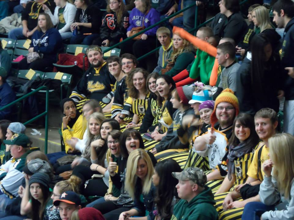 """Members of Mu Beta Psi (including Editor-in-Chief Alex Slepak, far left)wear their Pep Band stripes to a game at the Berry in Fall 2013. Photo credit: Jeremy """"Mr. Sunshine""""Loucks"""