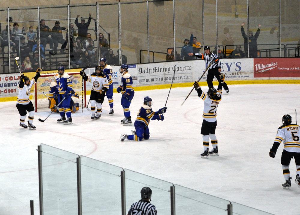 The Huskies celebrate a goal against Lake Superior State last Saturday (Photo credit: Bob Gilreath).