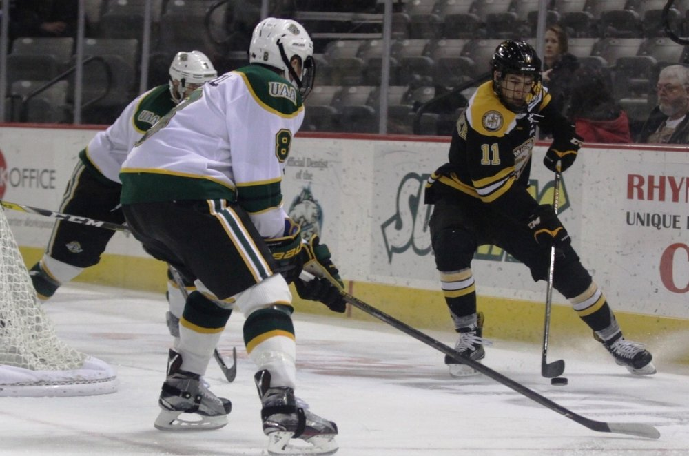 Tech Hockey Guide's 1st star of the weekend, Joel l'Esperance (1G, 1A, 10SOG), handling the puck in the offensive zone during Saturday's game (Photo Courtesy: Ryan Johnson)