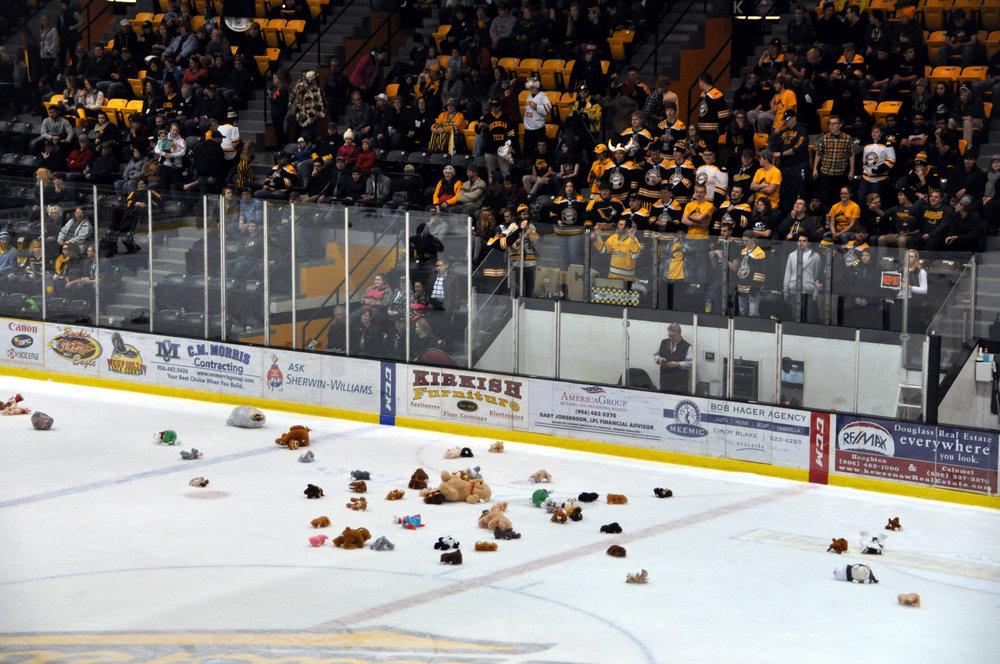 Misfits toss toys onto the ice Friday for the Teddy Bear Toss (Photo Courtesy of Bob Gilreath)