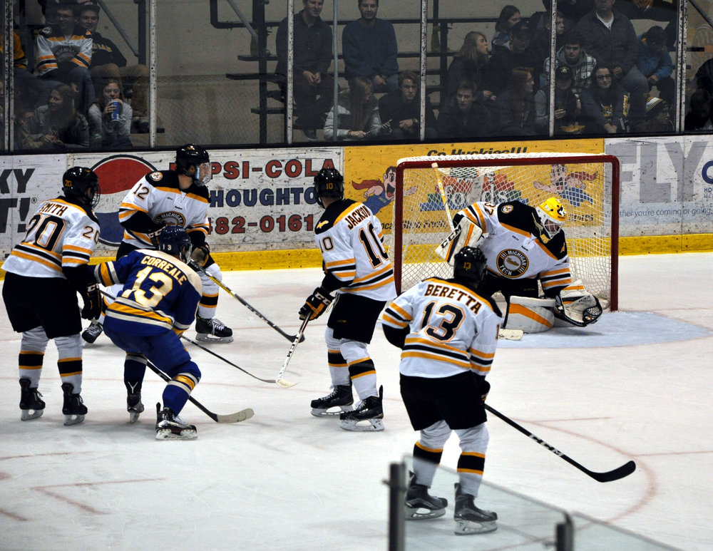 Angus Redmond looks for the puck against LSSU (Photo Credit: Bob Gilreath).