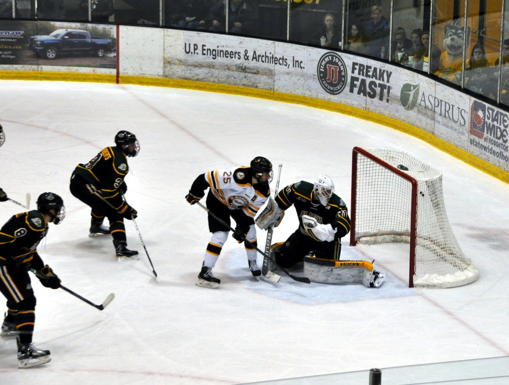Michael Neville (Sr., F) scored while all alone in the crease off of a beautiful pass from Reid Sturos (Sr., F). Neville switched to his backhand and put the puck top shelf (Photo credit Bob Gilreath).