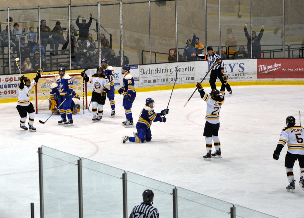 The Huskies celebrate a goal against LSSU in Houghton on Nov. 12, 2016 (Photo credit Bob Gilreath).