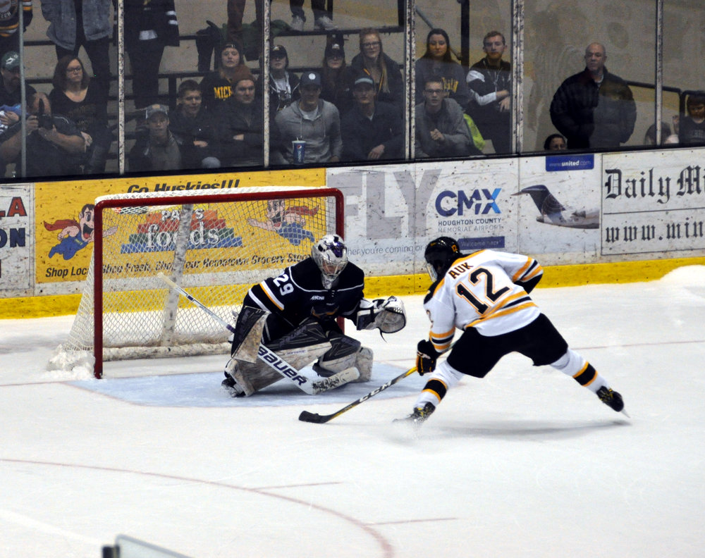 Blueliner Mark Auk lines up a shot against Mankato goaltender Aaron Nelson when Michigan Tech hosted the Mavericks earlier this season (Photo credit: Bob Gilreath).