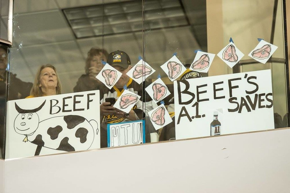 Fans count Angus Redmond's saves with steaks on the glass (Photo courtesy of Travis Pierce).