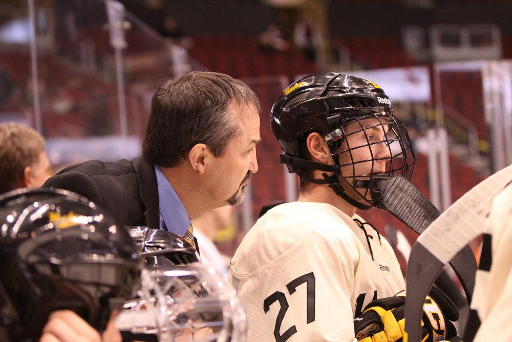 Coach Shuchuk checking in with his forwards (PHOTO CREDIT: Ryan Johnson)