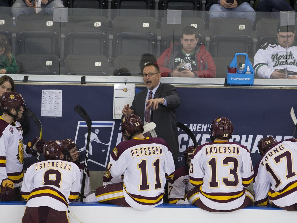 Jason Herter discussing strategy with the Bulldogs (PHOTO CREDIT: Jim Rosvold)