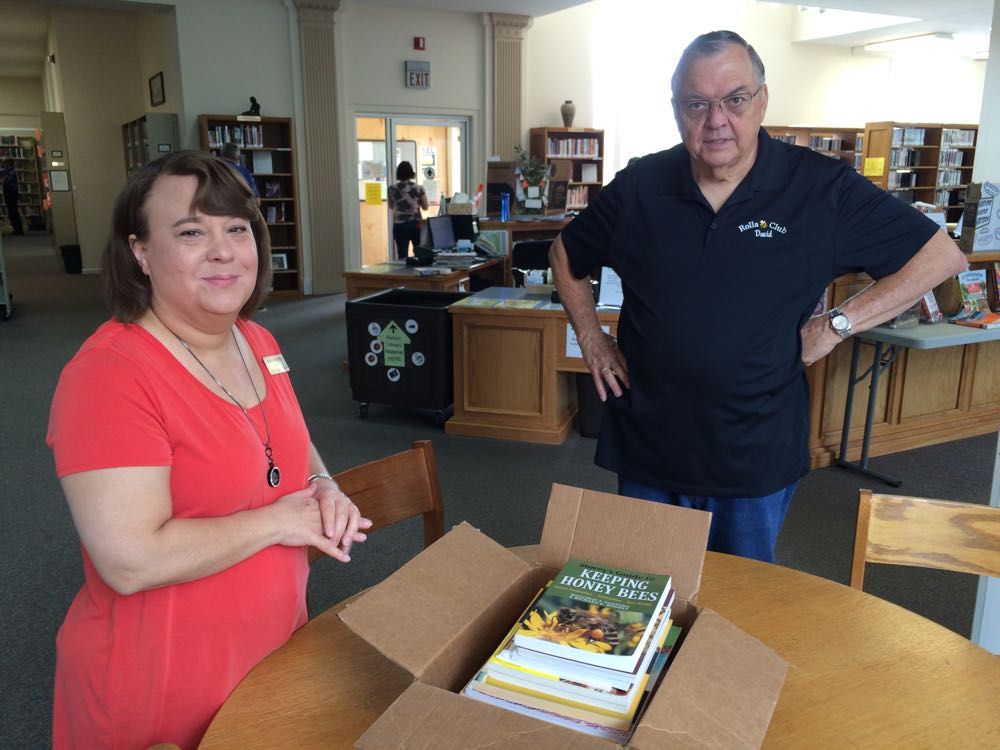 Rolla Public Library Director Diana Watkins takes a peek at beekeeping books donated by Rolla Bee Club, and my bee buddy, David Draker.
