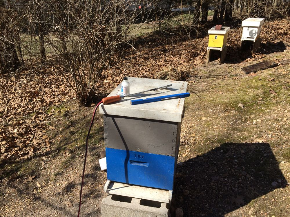 Setting up to test an oxalic acid treatment to an empty bee hive on a sunny winter day.