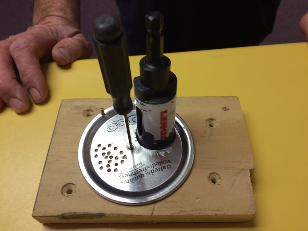 Here is a demo of how the holes are drilled using a wooden block guide.